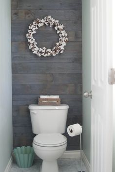 Plank wall stained in Minwax classic gray except tiles in the water closet
