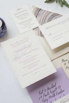 letterpress wedding invitation, purple, lavender, marble envelope liner, silk ribbon, traditional wedding invitation, calligraphy, vintage stamps