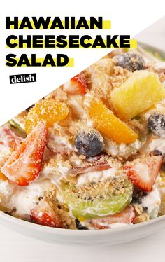 Hawaiian Cheesecake Salad tastes like vacation. Get the recipe at Delish.com. #recipe #easy #easyrecipe #fruit #salad #fruitsalad #cheese #cake #cheeseacke #berries #strawberries #blueberries #kiwi #pineapple #creamcheese #hawaii #dessert #dessertrecipes