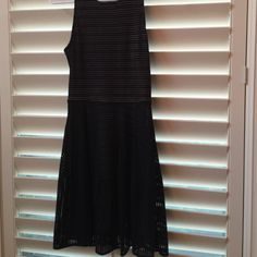 Beautiful BCBG dress Sleeveless black dress with zipper in back. Attached tan slip. Empire waist.  Great condition! Worn twice.  Pictured on a 5'2 model  115 lbs.  Adorable and classy!!  BCBG tends to run a little bigger so this fits more like an XS BCBGMaxAzria Dresses