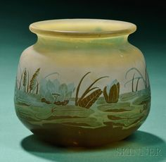 Galle Cameo Glass Vase  Art glass  France  Overlaid and etched with a waterscape with pond lilies in greens, blue, and browns, cameo signature Galle, paper label Emile Galle, Nancy, France.