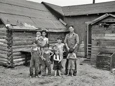 Pitchfork Manor: June 1937. Art Simplot and family in front of their house near Black River Falls, Wisconsin. Typical barefoot children, poor in material things, but proud, self reliant, accomplished, healthy, happy, family-centered. Photo by Russell Lee