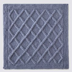 Knitterati Gradient Lapghan Block 2 by Deborah Newton using Cascade Yarns® 220 Superwash® Merino.  An all-over diamond/cable pattern is adorned with garter and seed stitch centers, and framed with a garter stitch border.
