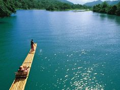 """Ocho Rios means """"eight rivers,"""" you shouldn't leave Jamaica without relaxing on a bamboo-raft trip down one of them - The Jamaica Tourist Board"""