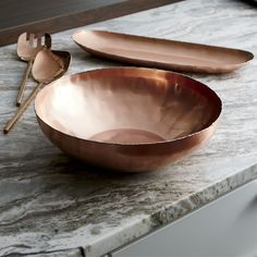 High-style serving in shining, glamorous copper. Our handcrafted bowl starts out in stainless steel, softly hammered to create the rich texture and welded to form the artisanal molten-edge detail. The exterior is then copper plated and polished to a gorgeous gleam, with a foodsafe lacquer finish allowing serving of salads, pasta and other dishes.