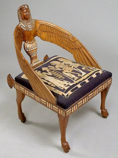includes four matching pieces. Sofa has over 1000 pieces of inlaid in elephant ivory, ebony and other exotic hardwoods on African mahogany base wood. Outstanding carving of ancient Egyptian motifs und