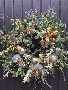 I made this on a Sarah Raven course - alternative Christmas colours with their own wintry charm. Eringium, deciduous ilex, lavendula dentata, viburnum, eucalyptus sprigs and berries, ivy sprigs and berries, alder and birch twigs - on an oasis base.