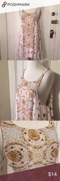 Intimately Free People pink pattern trapeze dress This is a light weight slip style trapeze back cut out dress from free people intimately, light pink with patterning. See pictures for details. Good condition, tiny holes starting to form on back, near Hemline. See pictures for details. Be sure and check out other items in closet and bundle to receive discounts. Free People Dresses