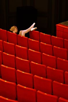 pointe shoes and red theater seats