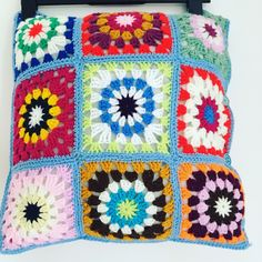 A personal favourite from my Etsy shop https://www.etsy.com/uk/listing/564030466/multicoloured-granny-square-cushion