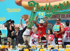 Contestants eat hot dogs at a hot dog eating contest at Coney Island of New York, the United States, July 4, 2017.  Joey Chestnut won his 10th title by eating 72 hot dogs in 10 minutes and Miki Sudo won her fourth straight title in the women's division by eating 41 hot dogs in 10 minutes at the 2017 Nathan's Famous International Hot Dog Eating Contest at Coney Island New York, the United States, July 4, 2017. The first Nathan's Famous International Hot Dog Eating Contest was held in 1916…