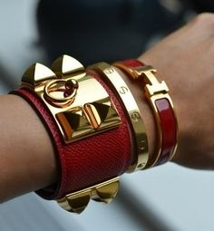 -Clic H Bracelet by Hermes -Collier de Chien by Hermes (both red with yellow gold finish) -Love Bracelet (yellow gold) by Cartier Hermes Armband, Hermes H Bracelet, Hermes Jewelry, Cartier Love Ring, Cartier Love Bracelet, Hermes Birkin, Hermes Belt, Love Bracelets, Bangles