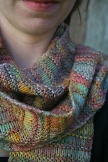 This is a super simple scarf that knits up very quickly. The elongated stitch pattern is made by creating yarnovers that get dropped on the following row. The rest is plain garter stitch.