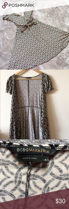 BCBG Wrap Dress True style wrap dress in excellent used condition. Very soft stretchy material, size small but because it's a wrap dress I can also fit a medium. BCBGMaxAzria Dresses