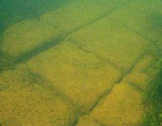 "Prehistoric Underwater Structure, NW Wisconsin - The discovery was made July 24, 2007 during an underwater exploration of a remote tributary in the upper Mississippi River basin. Though likely of natural origin, the site appears to be an ancient underwater structure, possibly a road or causeway and constructed of flat, rectangular-shaped blocks of stone that appear to be cut or worked and fitted into place. To the casual eye, the ""structure"" resembles other roads and ruins found in…"