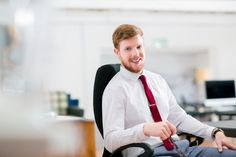 Happy businessman sitting on office chair