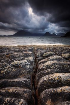 The ever changing weather conditions provided some very interesting shots from my short time in Elgol, on the Isle of Skye. The rocks on the shore are incredibly diverse, and very interesting subjects. This shot looks out over Loch Scavaig towards the Cuilins.