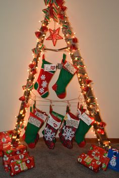 We wanted a mobile Christmas Tree Stocking Holder so we could take to celebration at my daughters. We came up with this decorated ladder. It worked perfect! Ladder Christmas Tree, Christmas Stairs, Diy Christmas Gifts, Winter Christmas, Christmas Tree Decorations, Christmas Trees, Holiday Decor, Christmas Stocking Hangers, Stocking Tree