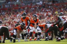 Trevor Siemian Photos Photos - Quarterback Trevor Siemian #13 of the Denver Broncos controls the offense during the first quarter of an NFL game against the Tampa Bay Buccaneers on October 2, 2016 at Raymond James Stadium in Tampa, Florida. - Denver Broncos v Tampa Bay Buccaneers