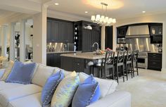 My dream kitchen...huge island, and totally open to dining and living!!