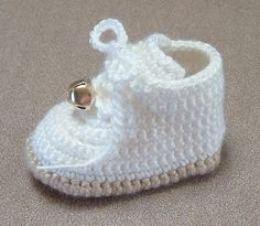 Remember the classic high-top baby's first walking shoes with the jingle bells on them? Here's a PDF crochet pattern for baby booties that look just like those shoes. https://www.craftsy.com/pattern/crocheting/Accessory/Baby-HikingWork-Boots-Booties/11994