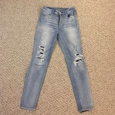 American Eagle stretchy distressed blue jeans Light blue distressed jeans from AEO, it's super stretchy and really comfortable, soft wear - fits size 6-8 bottoms. From the Super Sky High Jegging collection! American Eagle Outfitters Jeans Skinny