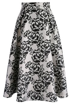 Classic black and white is only made all the more fancy and feminine with fun peonies printed all about. Step out in this traditional statement midi skirt with your favorite cropped sweaters this season.  - Texture metallic jacquard pattern - Concealed back zip closure - Lined - 95% polyester, 5% metallic fiber