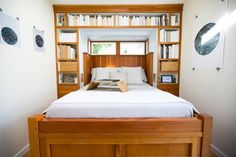 """Tiny house cratsman style bedroom - Notice cut-outs to allow easy access to """"nightstand"""" from bed"""