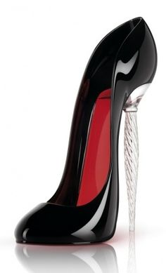 "Christian Louboutin Wine glass...and he calls it that, because after a glass, you'll fall on your....toosh! =) L.O.V.E.  the design, but it's too ""high,"" even for me!"