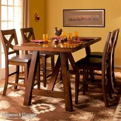 If warm and cozy is your motto, turn your dining room into an inviting and rustic gathering spot with golden walls, and earthen, trunk-inspired accent chest and a rug reminiscent of the Southwest. This color scheme is great for fall decorating!