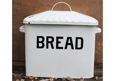 Enamel Metal Bread Box  - From Antiquefarmhouse.com - http://www.antiquefarmhouse.com/current-sale-events/farmhousekitchen/enameled-metal-bread-box.html SOLD OUT but I'm hoping they get more in!  :)