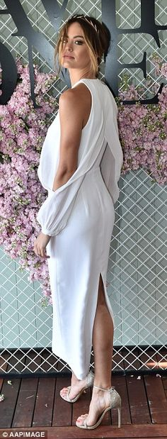 The floor-length gown featured a back split to the thigh and open sleeves...