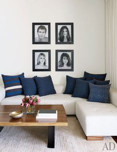 On the other side of the room, portraits of the family, taken by Brian Bowen Smith, are displayed over a custom-made sectional sofa; the striped pillow fabrics are by Ralph Lauren Home, the vintage ikat pillow is from John Robshaw, and the carpet is by Lawrence of La Brea.