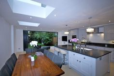 A large contemporary kitchen extension with an effortless transition to the outside garden space, House Extension Plans, House Extension Design, House Design, Extension Ideas, Kitchen Extension Glass, Living Room Spotlights, Conservatory Kitchen, Open Plan Kitchen Living Room, House Extensions