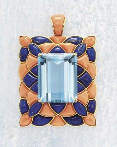 CARTIER An Aquamarine Lapiz Lazuli and Coral Pendant, circa 1950