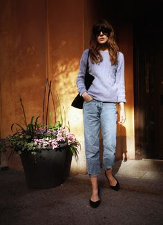 Baggy jeans, sweater, flats.