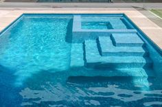 Rectangular pool with spa and steps within rectangular foot print Glass Pool Tile, Pool Tiles, Swimming Pools Backyard, Pool Landscaping, Pool Retaining Wall, Pool Fountain, Rectangular Pool, Small Pools, Plunge Pool
