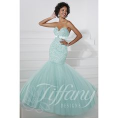 Tiffany Design Style 16086 This gorgeous gown has a strapless sweetheart neckline and a fitted torso that is fully embellished in intricate pearl and rhinestone detailing. The Slim Flared mermaid tulle skirt completes your hourglass figure by complimenti