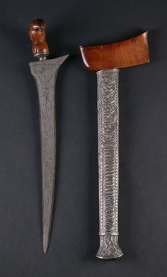 Indonesian Kris and scabbard with crazy metal work.
