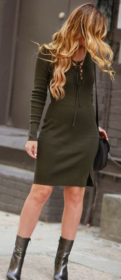 Olive green lace up long sleeve dress styled with silver ankle booties, and grey studded saddle bag