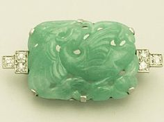 A fine and impressive antique jade and diamond, 18 carat white gold brooch; part of the AC Silver jewellery range  http://www.acsilver.co.uk/shop/pc/0-35-ct-Diamond-Jade-and18-ct-White-Gold-Brooch-Antique-Circa-1940-87p3421.htm