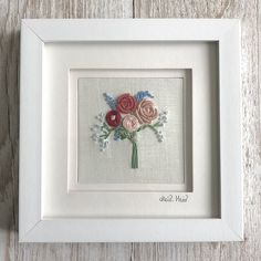 Embroidered bouquet of flowers with pink and red roses with complementary blue flower sprigs, hand stitched by textile artist Heidi Meier. This little square floral embroidery is an exquisite piece of textile art, constructed using bullion knots, frenc. Hand Embroidery Tutorial, Embroidery Flowers Pattern, Rose Embroidery, Embroidery Applique, Embroidery Software, Embroidery Digitizing, Embroidery Techniques, Blue Flowers, Red Roses