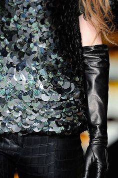 Beautiful #detail of a sequinned top and leather pants and gloves from the #RobertoCavalli FW 2012-13 runway show!