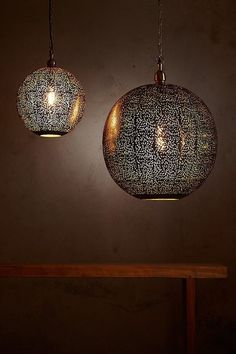 Two sizes of round pendants featuring delicately-patterned perforated nickel spheres. When unlit the metallic silver exterior shows the delicate perforations, when illuminated the glowing gold interior radiates out. Gold Interior, Round Pendant, Kitchen Living, Taurus, Pendant Lighting, Boho Chic, Sweet Home, Glow, New Homes