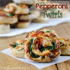 Pepperoni Twirls - Put a new spin on pizza night with these fun pinwheel-like pizza dough discs featuring pepperoni, mozzarella, and spinach!
