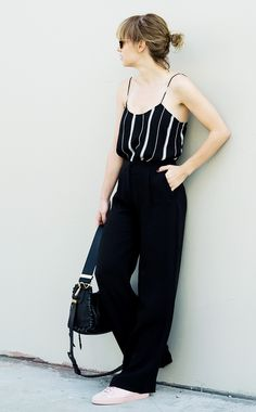 Tuck a slinky camisole into a pair of roomy trousers; add sneakers