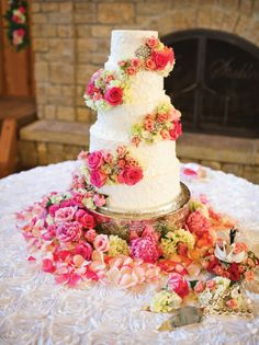 The couple's wedding cake, created by Celebrations by Sonja, was accented with a beautiful array of fresh flowers.