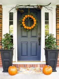 28 Inviting Colors to Paint a Front Door: This deep, rich blue shows off seasonal décor to great advantage (lush spring ferns also look fantastic against it). The door belongs to blogger Ann Drake (onsuttonplace.com), who likes to change up her color and accessories to keep her look fresh. The color shown is Sherwin-Williams Naval Blue. From DIYnetwork.com