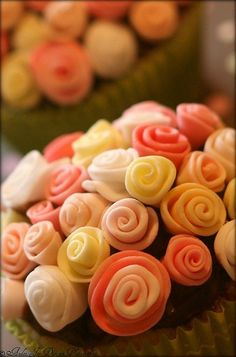 This doesn't have a proper link- but it's a cute way to roll fondant to make a rose cupcake. Beautiful- but a lot of work for 1 cupcake!