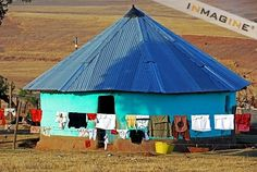 South Africa: simple, colourful hut in Qunu, Nelson Mandela's birthplace. The Transkei, Eastern Cape province. African Love, African Art, Kenya, Airport Theme, Virginia Camping, People Around The World, Around The Worlds, Dubai, African Nations
